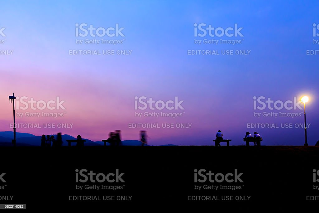 Silhouette of people in activity at evening twilight stock photo