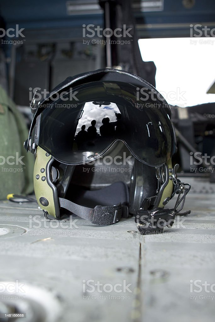 Silhouette of people looking at pilot helmet stock photo