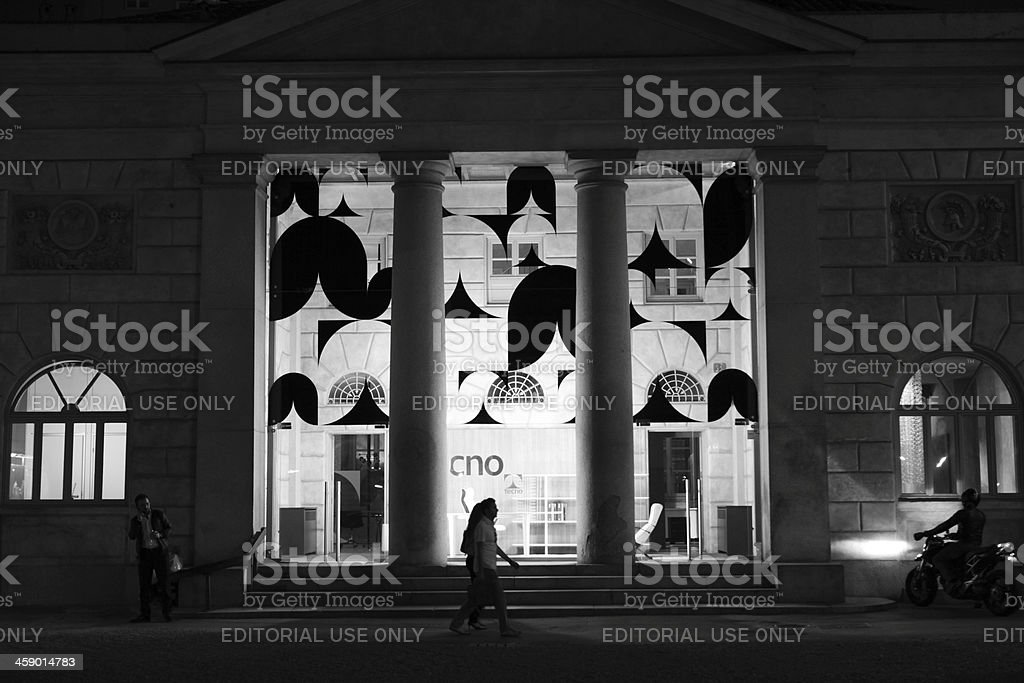 Silhouette of people passing Tecno shop in Milan, Italy royalty-free stock photo