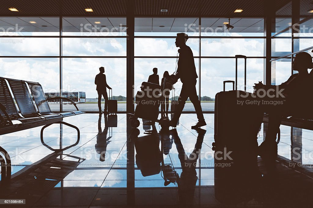 Silhouette of people waiting at airport stock photo