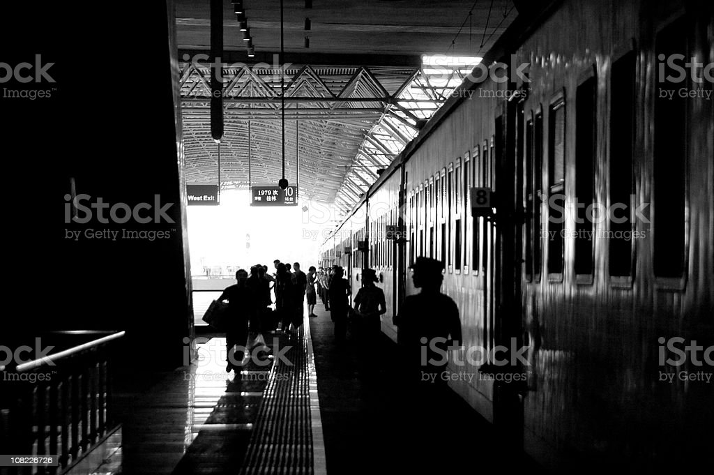Silhouette of People Waiting at Train Station royalty-free stock photo