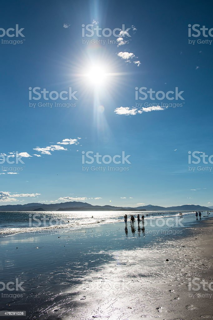 Silhouette of people walking on a beach in Costa Rica stock photo