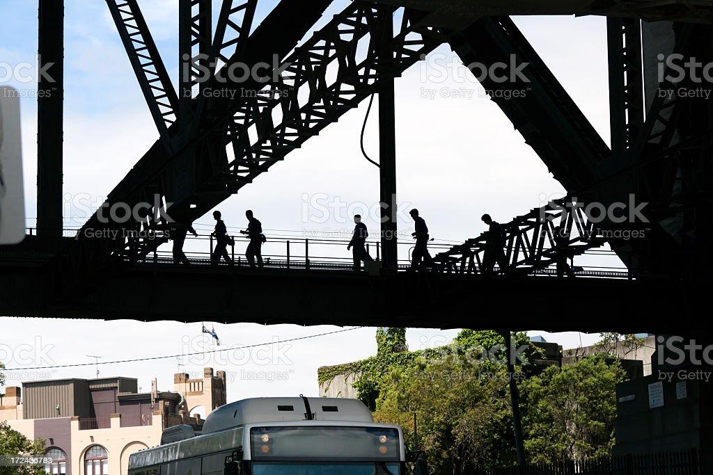 Silhouette of people walking on Harbour Bridge, Sydney Australia royalty-free stock photo