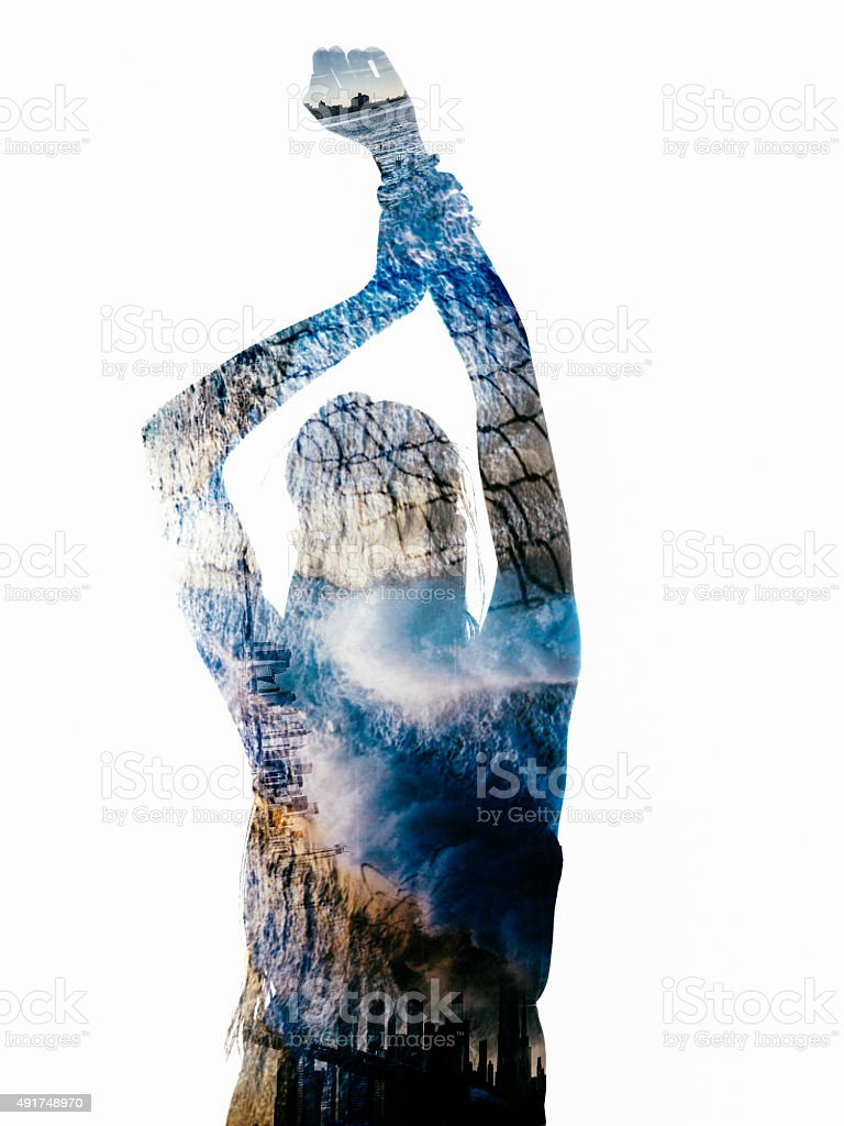 Silhouette of person filled with images of water and cities stock photo