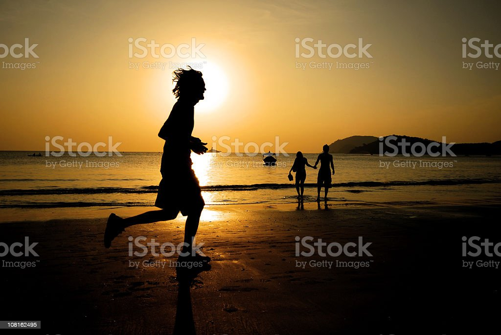 Silhouette of Person Running on Beach royalty-free stock photo