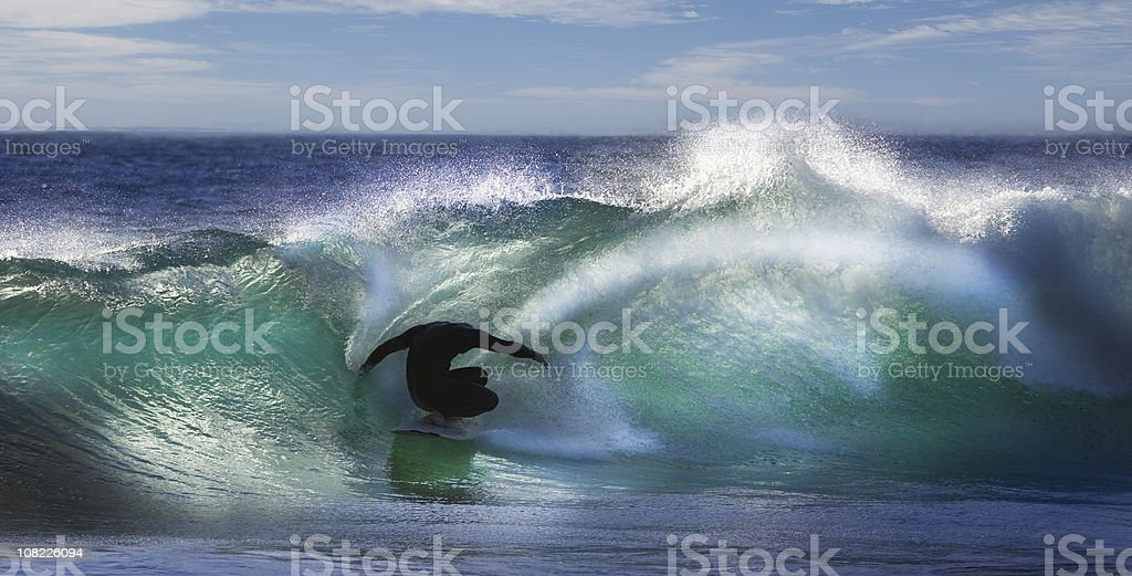 Silhouette of Person Surfing in Waves royalty-free stock photo