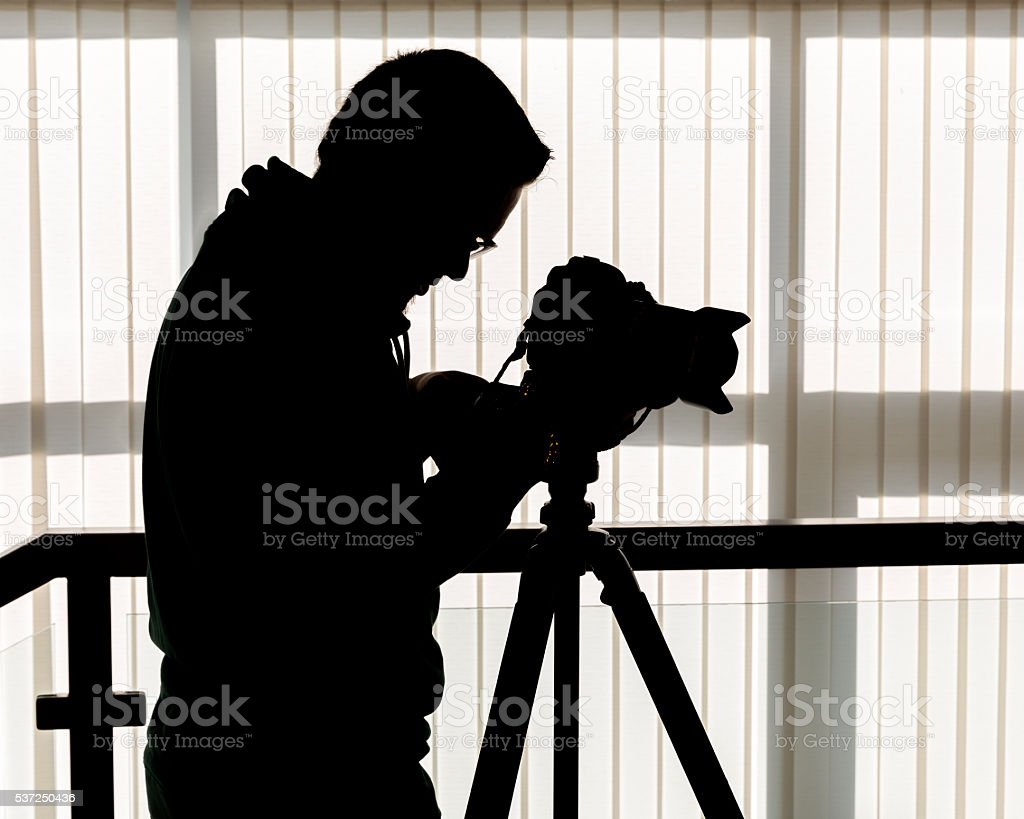 Silhouette of photographer and cameraman stock photo