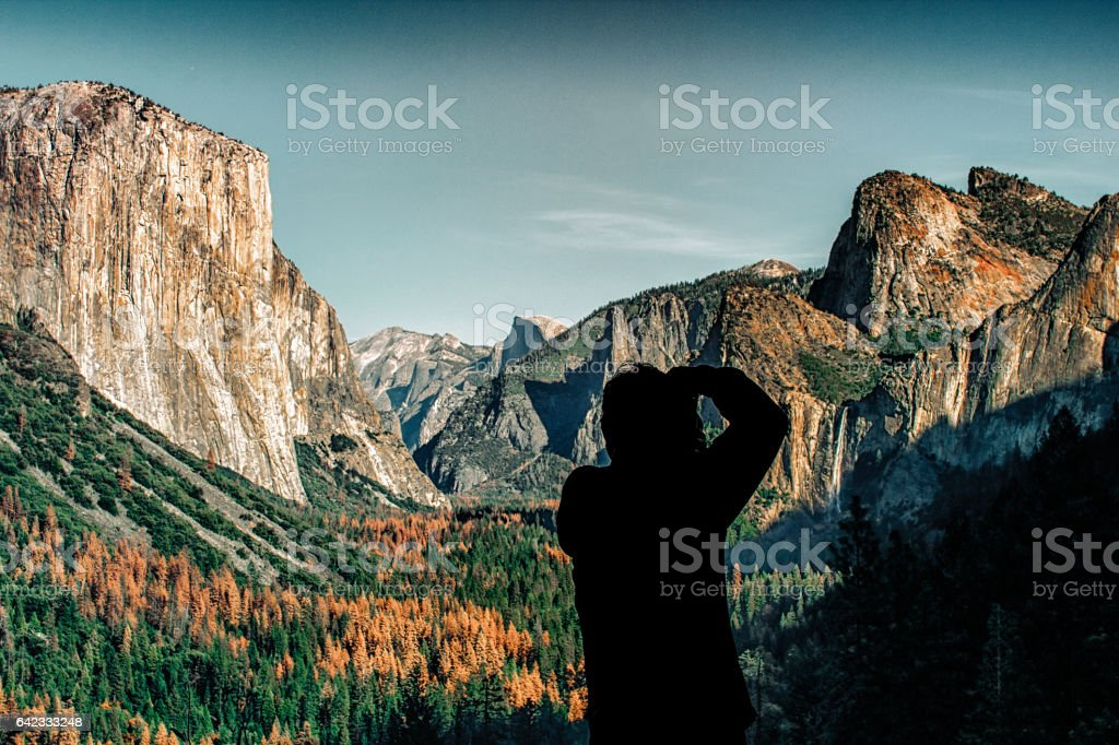 Silhouette of Photographer taking photo of Yosemite Valley from Tunnel View stock photo