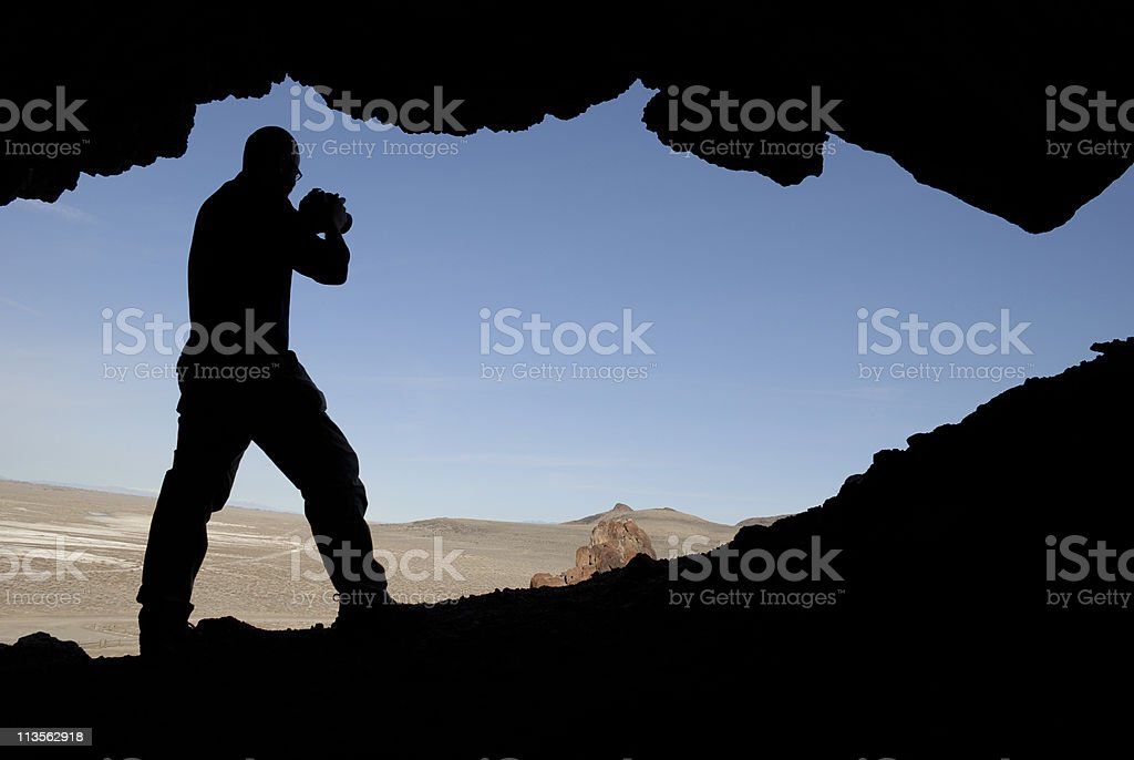 Silhouette of Photographer with Camera royalty-free stock photo