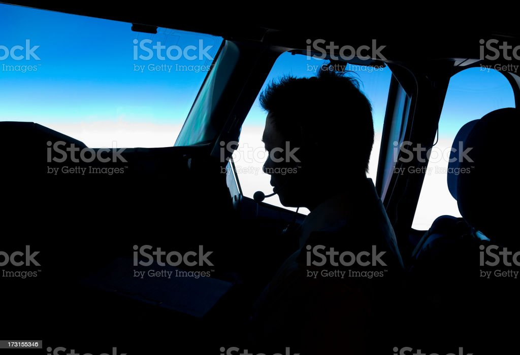 Silhouette of Pilot in Cockpit stock photo