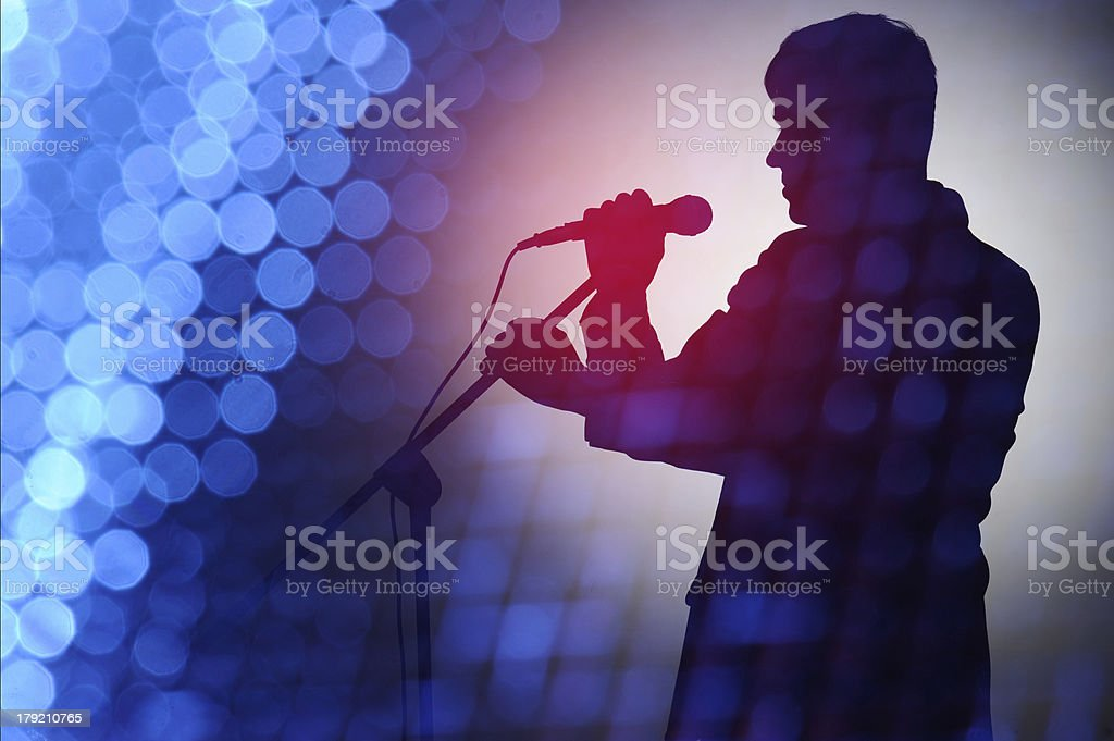 Silhouette of pop singer and presenter. stock photo
