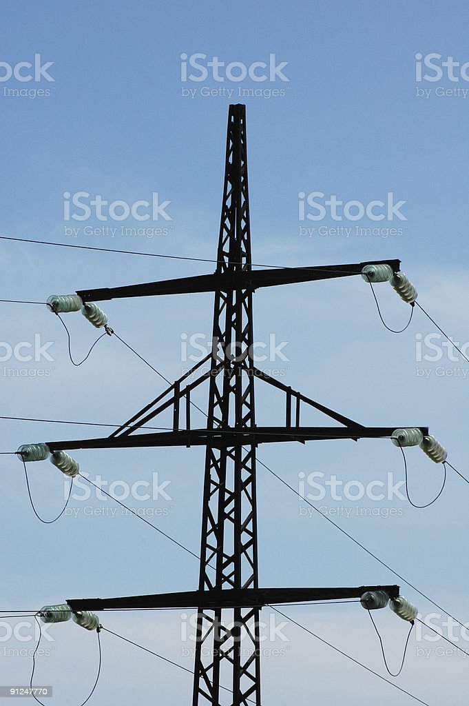 Silhouette of power line against bright blue sky royalty-free stock photo