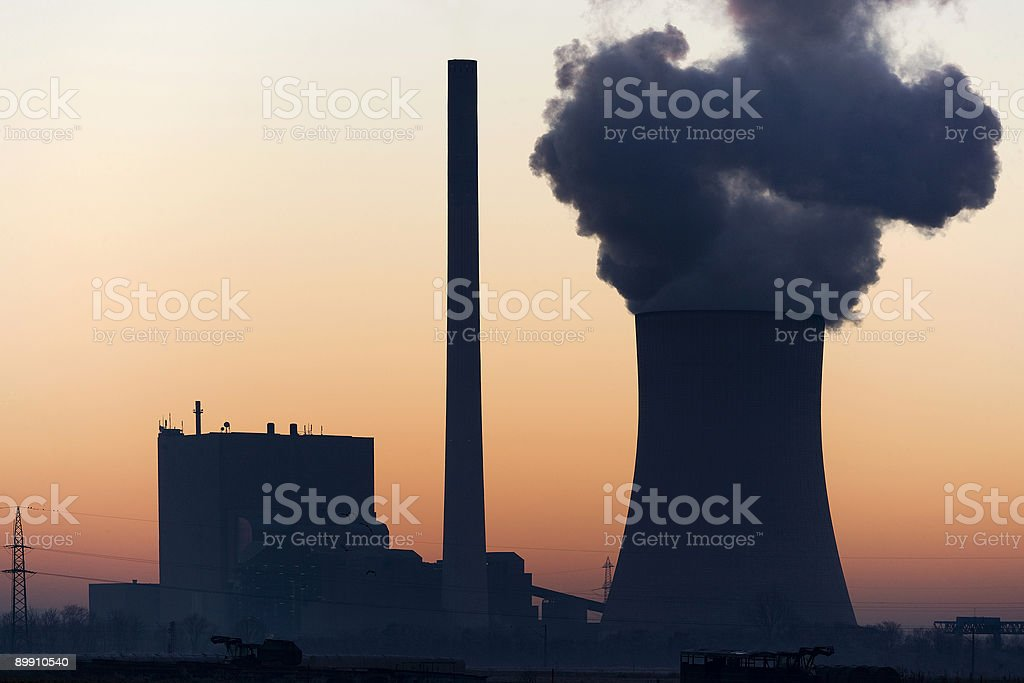 Silhouette of Power station back lit at sunset royalty-free stock photo