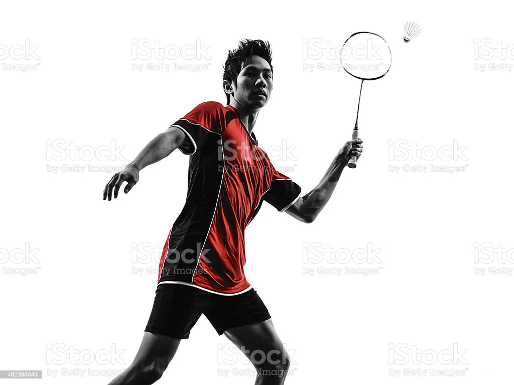 Silhouette of practicing young badminton player stock photo