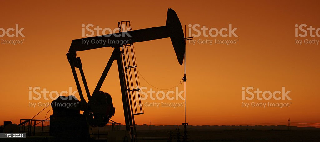 Silhouette of Pumpjack in Texas stock photo