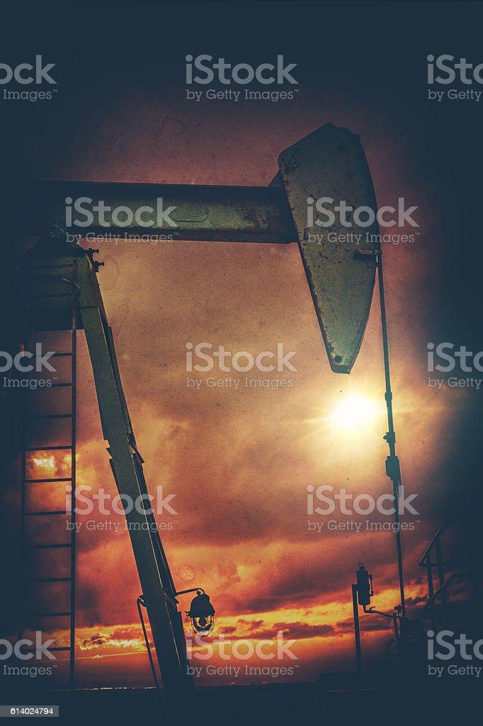 Silhouette of pumpjack stock photo