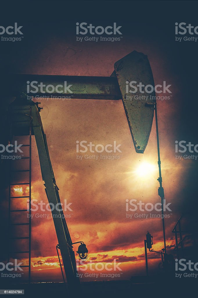 Silhouette of pumpjack stock photo