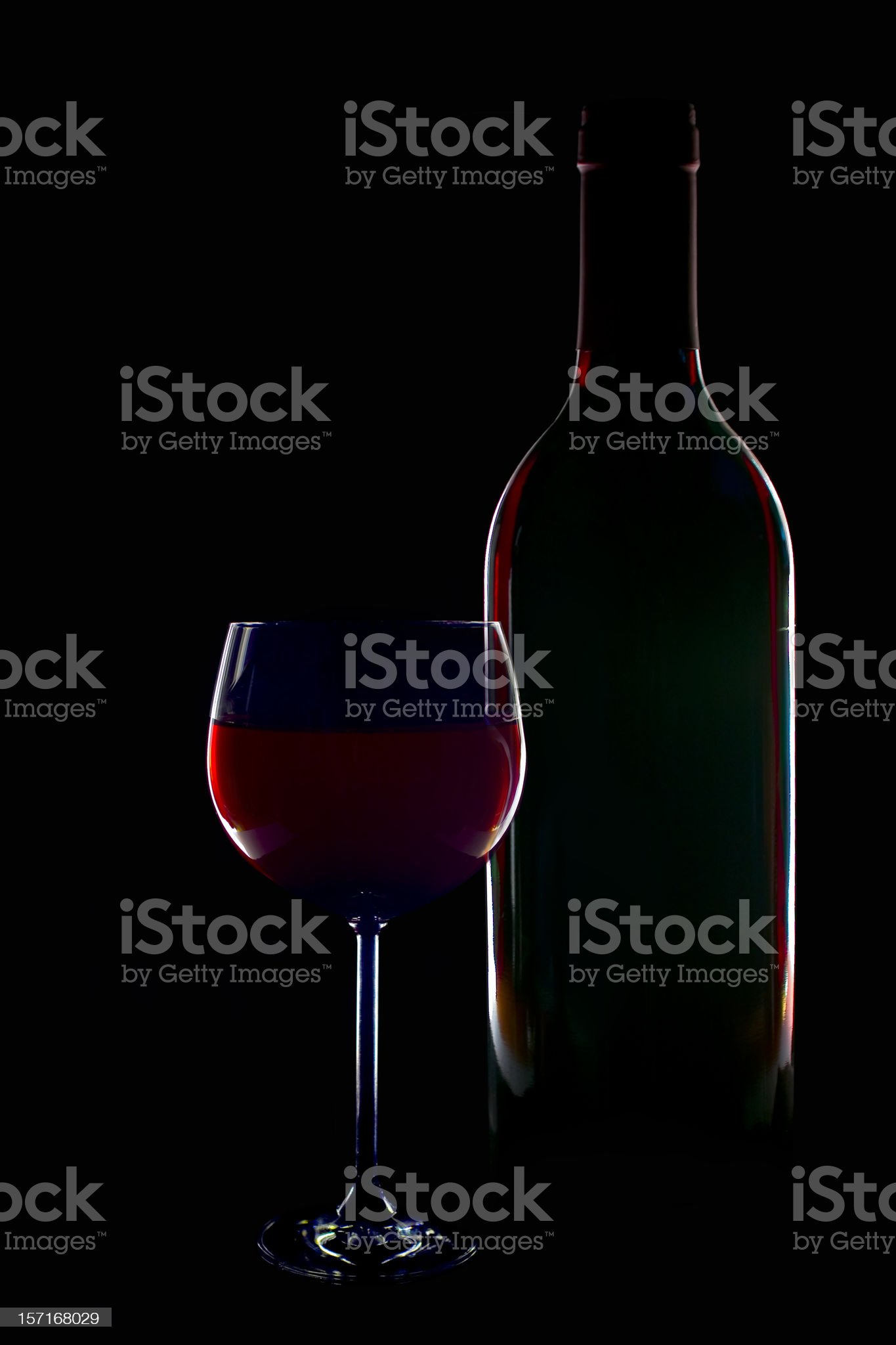 Silhouette of red wine bottle and glas royalty-free stock photo