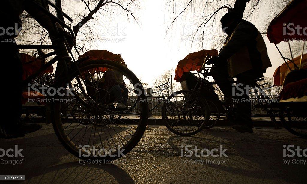 Silhouette of Rickshaw Drivers royalty-free stock photo