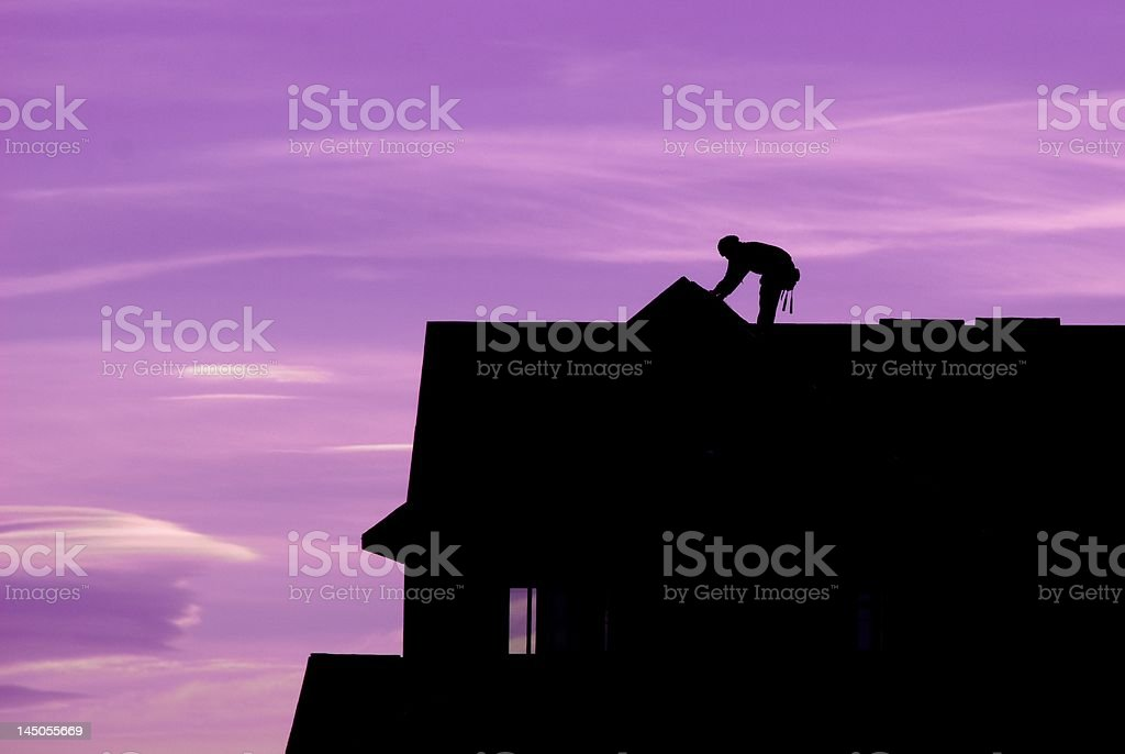Silhouette of Roofer stock photo