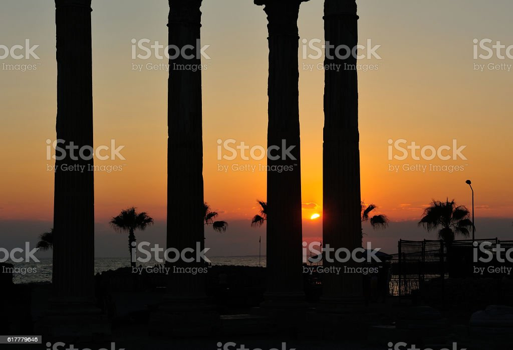 Silhouette of ruins of the Temple of Apollo at sunset stock photo