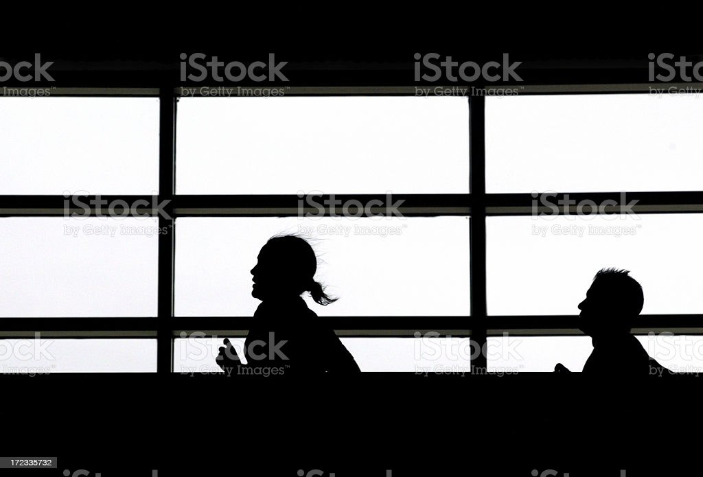 Silhouette of runners inside a gym royalty-free stock photo