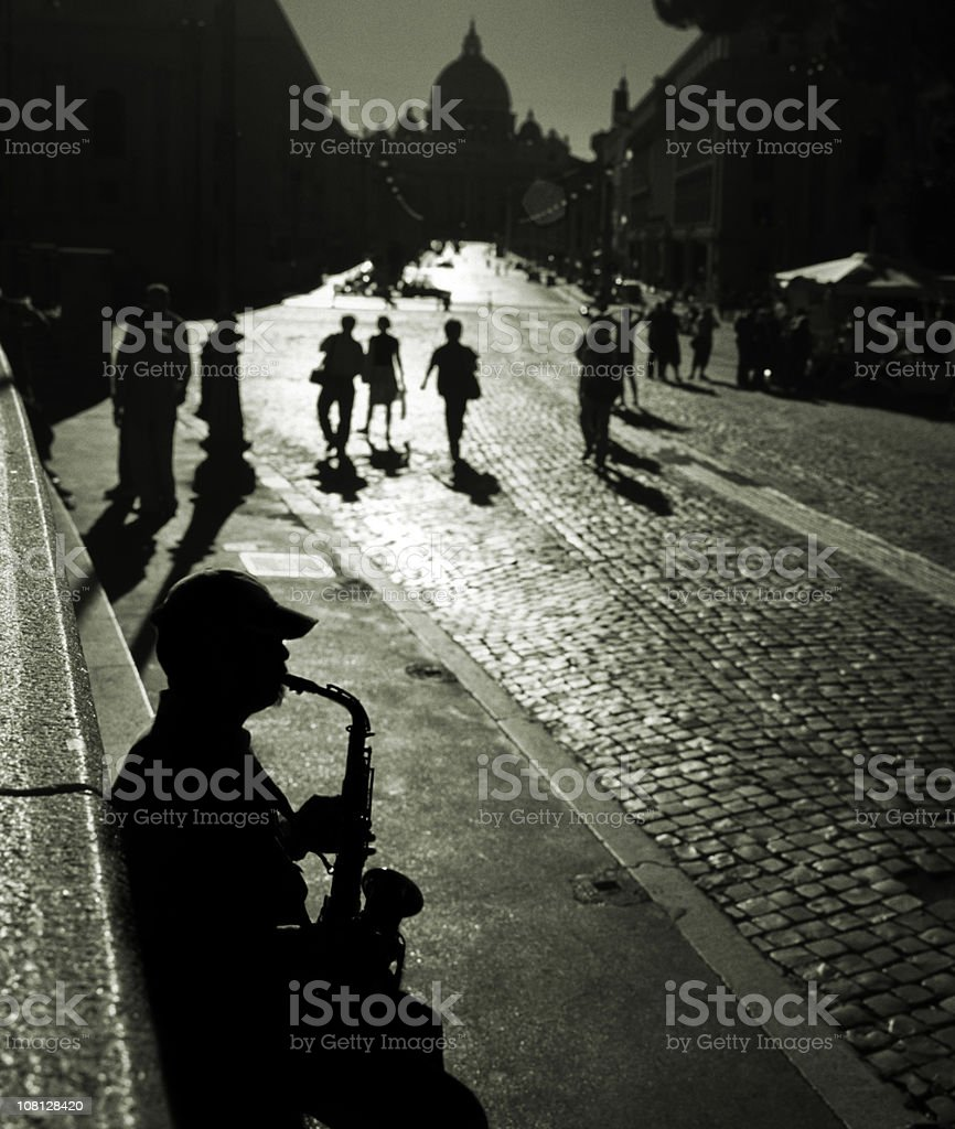 Silhouette of  Saxophone Player, St. Peter's Basilica, Rome, italy royalty-free stock photo