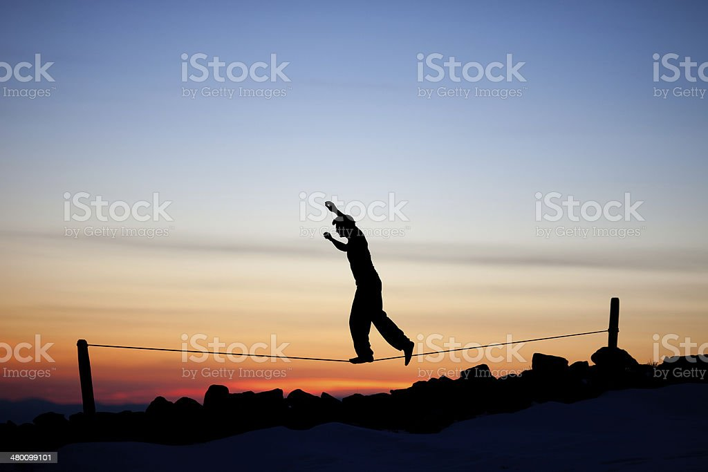 silhouette of slackliner stock photo