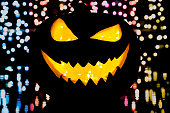 Silhouette of smiling pumpkin on black