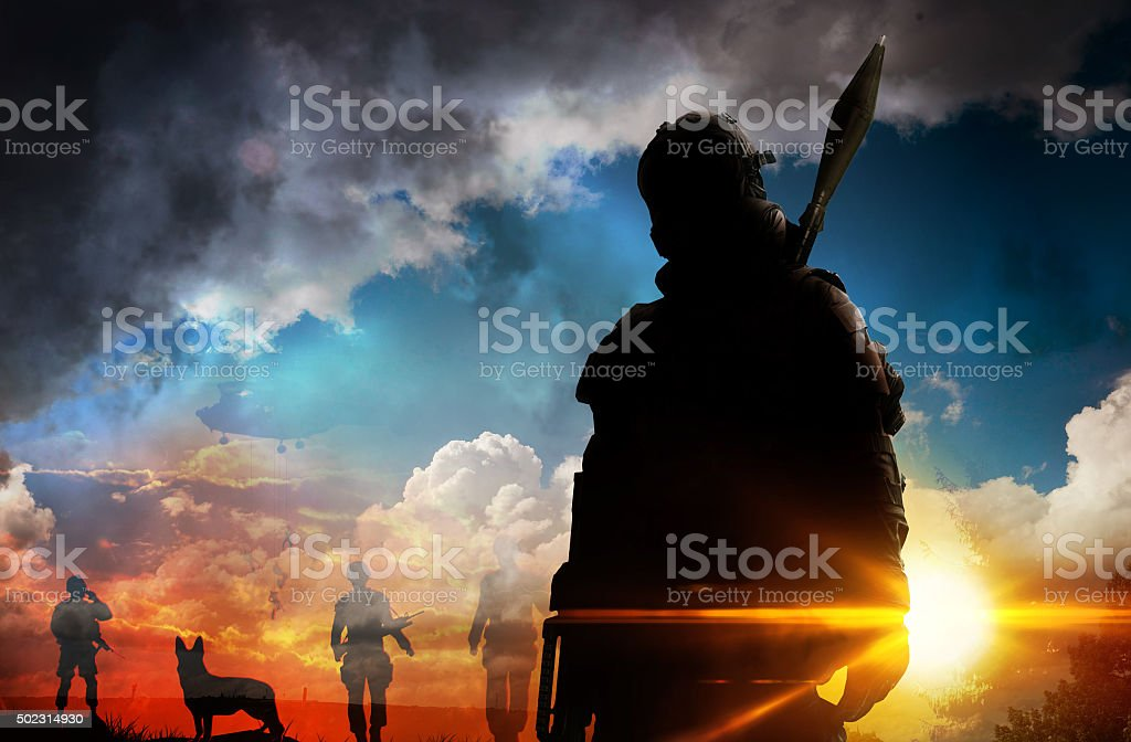 Silhouette of soldier at sunset stock photo