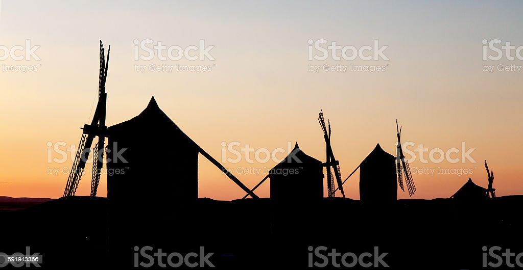 Silhouette of Spanish windmills at sunset stock photo