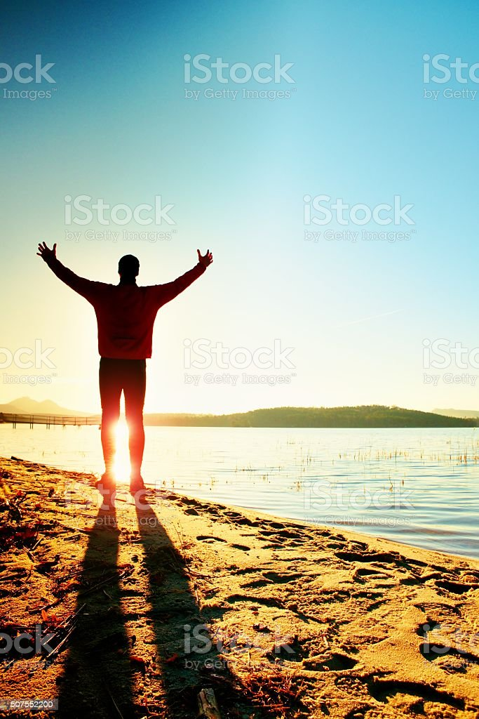 Silhouette of sport active man running and exercising stock photo