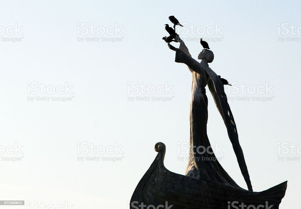 Silhouette of St Nicholas monument with live cormorants on it, Old Town Nesebar, Bulgaria stock photo