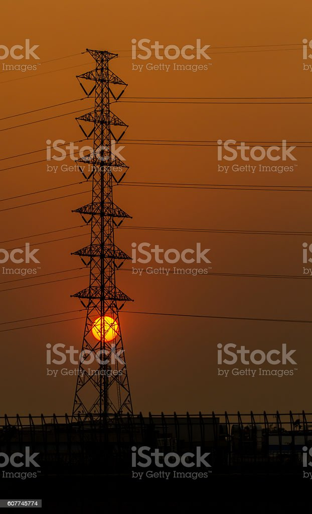 Silhouette of Street lights in sunset sky royalty-free stock photo
