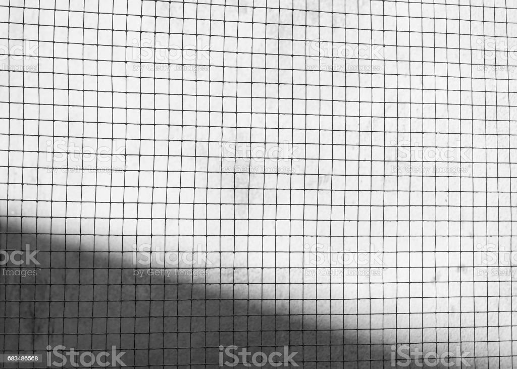 Silhouette of Structure mesh metal fence stock photo