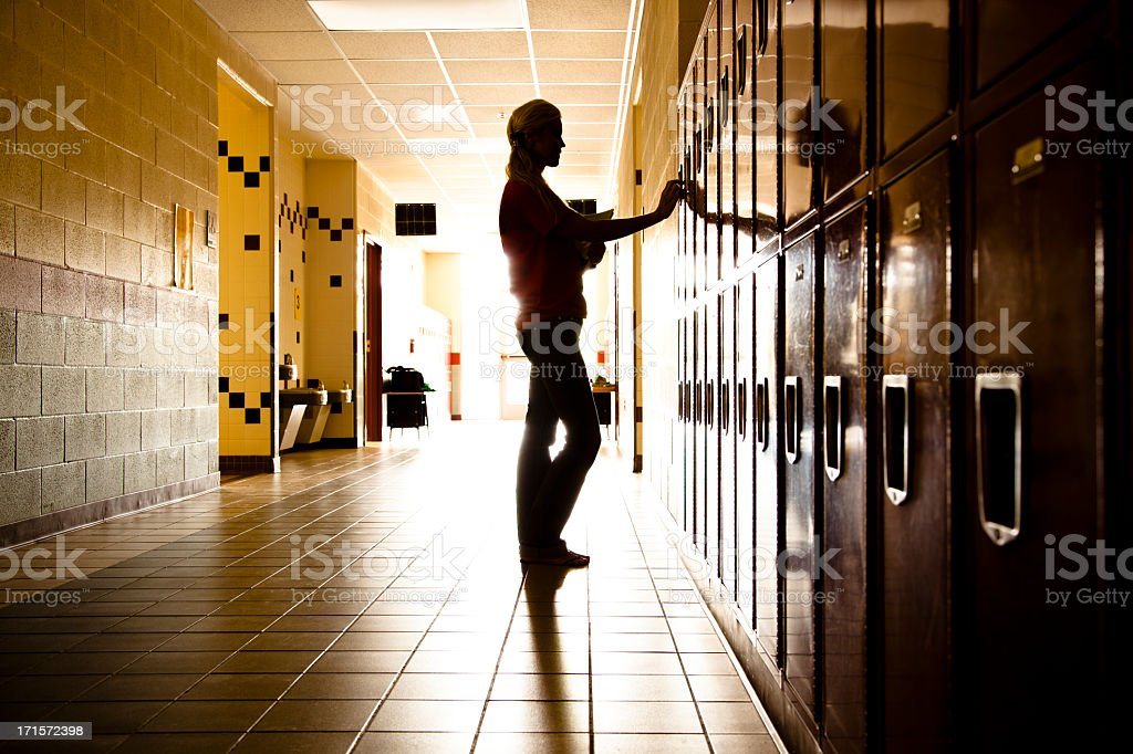 Silhouette of Student in hallway. Lockers. High school. Girl. Education. stock photo