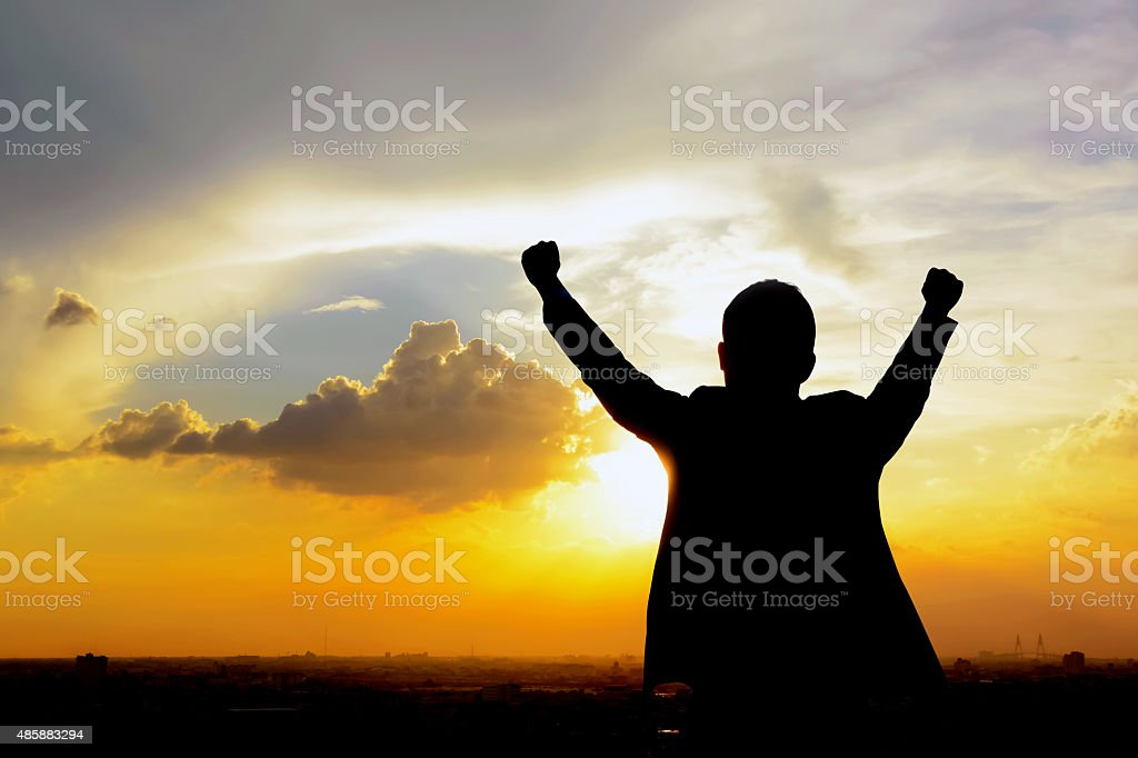 Silhouette of success man raising his arms stock photo