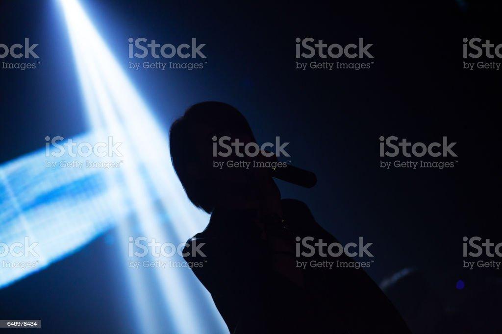 Silhouette of thai rock singer against ligthbeams stock photo