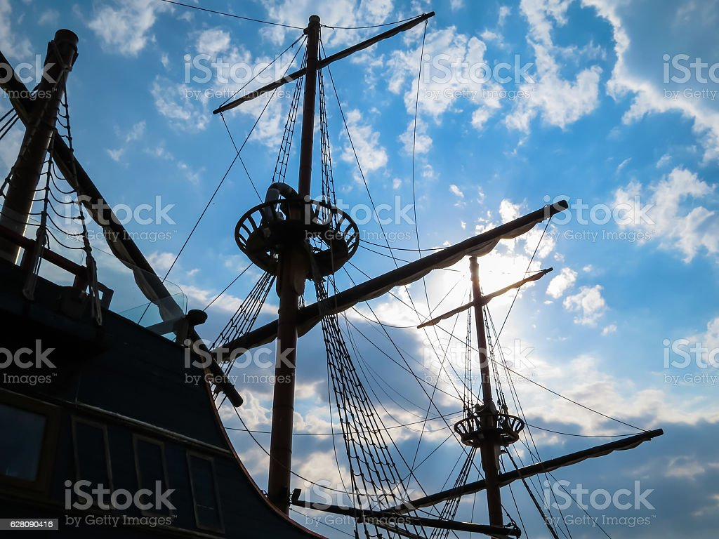 Silhouette of the ancient sailing ship stock photo