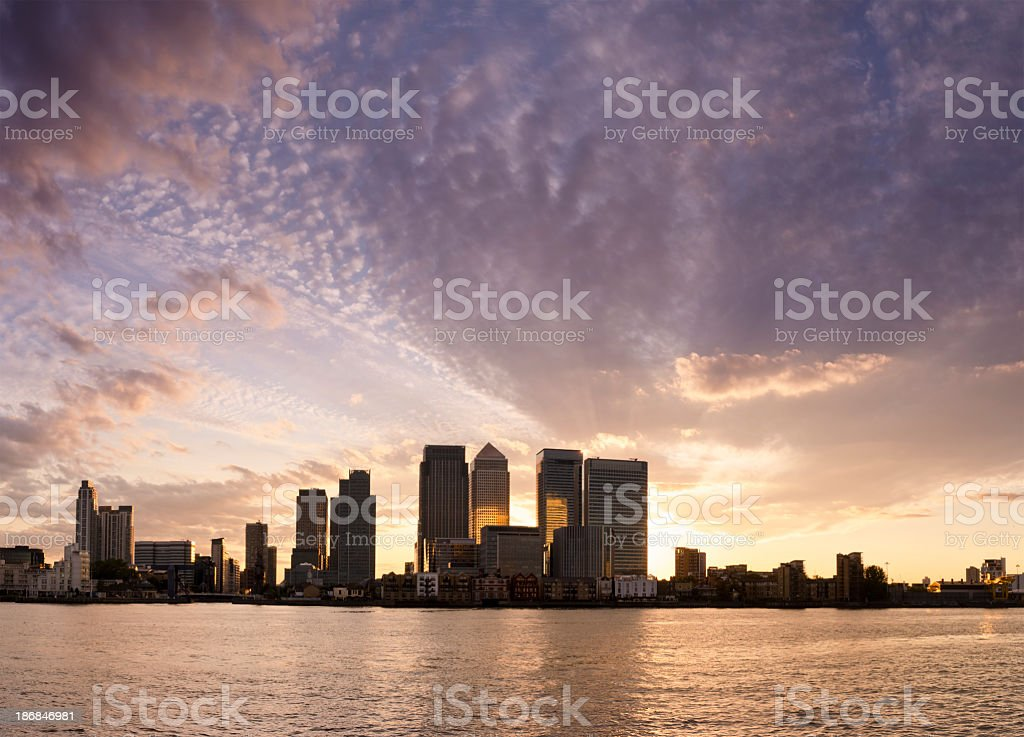 Silhouette of the Canary Wharf skyline at sunset stock photo