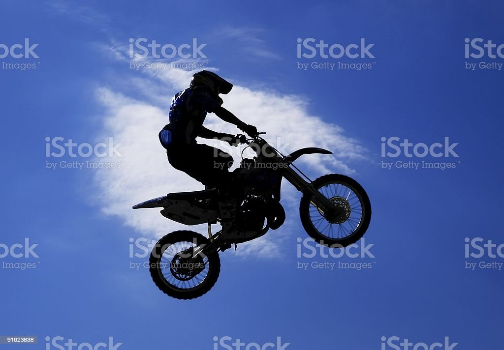 Silhouette of the jumping motorcyclist royalty-free stock photo