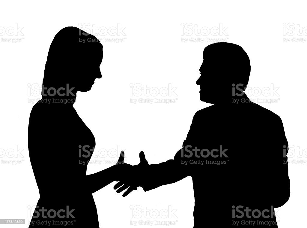 Silhouette of the man shaking hand to young woman stock photo