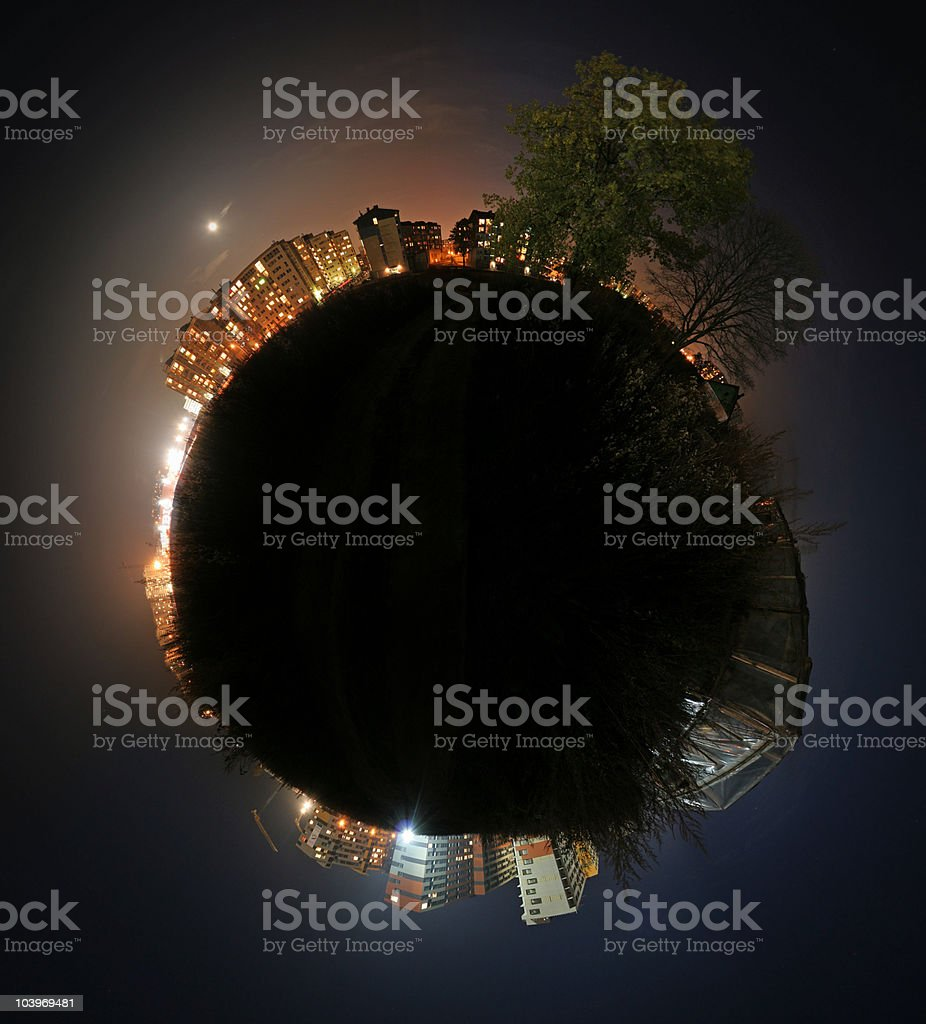Silhouette of the world, lit up with city lights stock photo