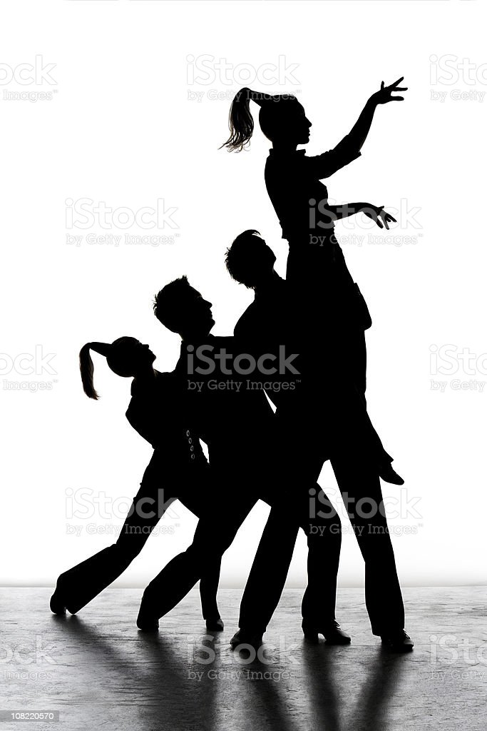 Silhouette of Three Dancers Holding Up Woman royalty-free stock photo