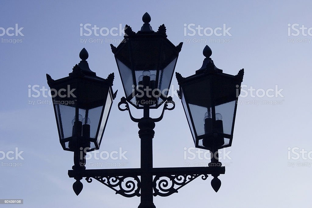 silhouette of three lanterns royalty-free stock photo
