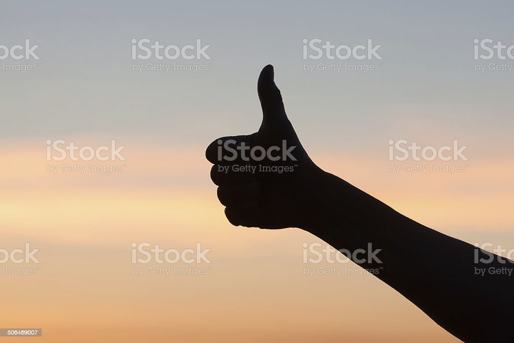 Silhouette of thumb up hand royalty-free stock photo