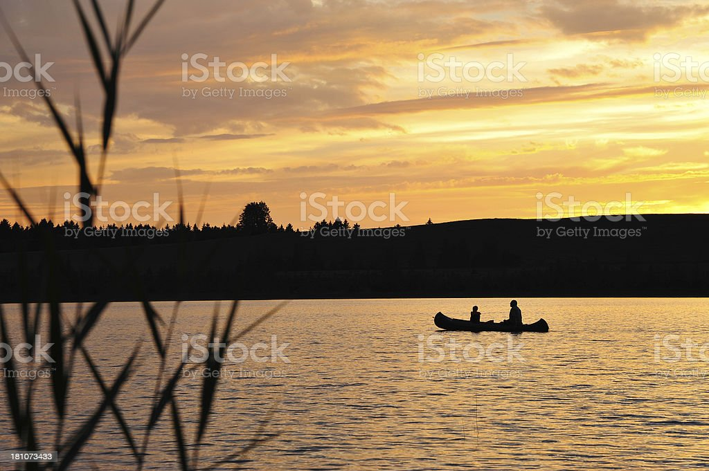 Silhouette of Two People Kayaking stock photo