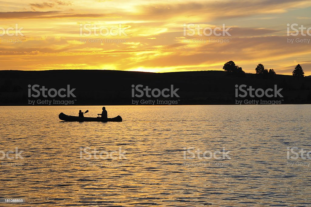 Silhouette of Two People Kayaking royalty-free stock photo