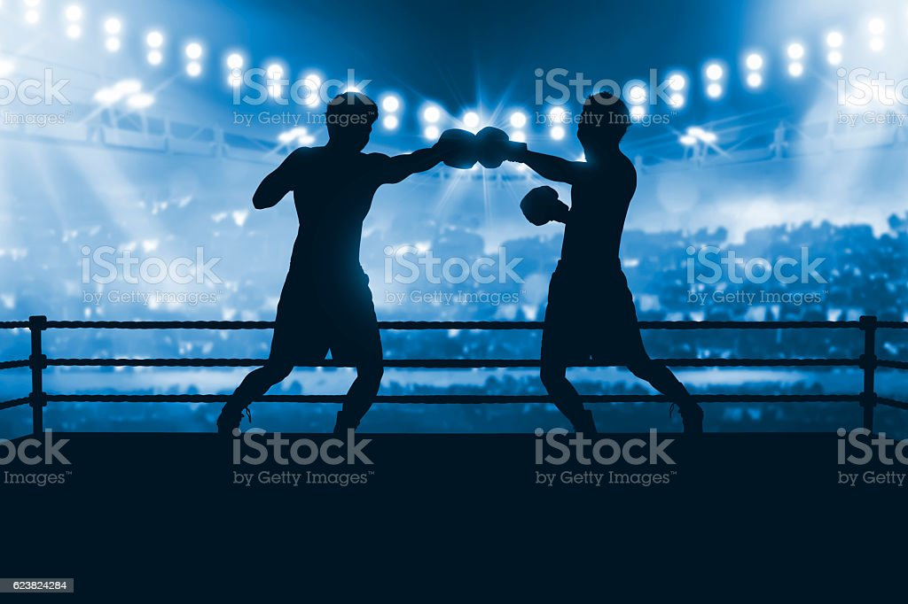 Silhouette of two professional asian boxer fight in the boxing stock photo