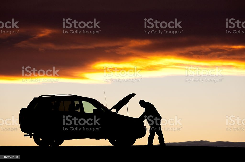 Silhouette of Unregnizable Adult Male Having Car Trouble stock photo